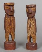 Two Eastern Arnhem Land Mokoy figures Both typically worked. The larger 21 cm high.