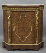 A 19th century marble topped ormolu mounted amboyna pier cabinet The shaped variegated marble top
