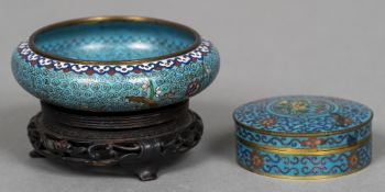 A late 19th century Chinese cloisonne bowl Of shallow form, decorated with floral sprays,