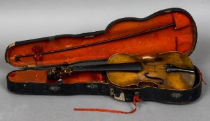 A 19th century violin With single piece back and lion carved stock; together with a bow,