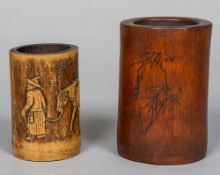 A Chinese carved bamboo brush pot Worked with calligraphic script opposing a bamboo spray;