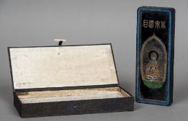 A boxed Chinese ink block Decorated to one side with Buddha,