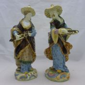 A pair of late 19th century Majolica chinoiserie figurines