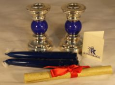 A boxed pair of silver and lapiz candlesticks