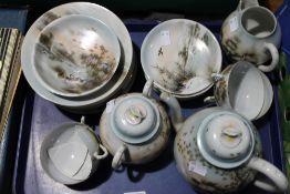 A Japanese porcelain tea set