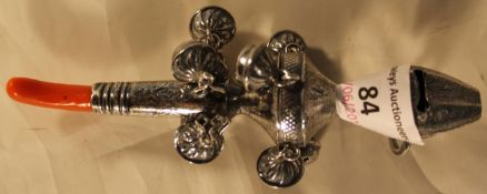 A silver baby's rattle