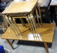 A burrwood nut nest of tables and a coffee table