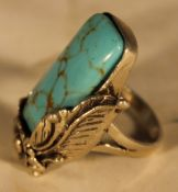 A silver and turquoise ring