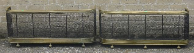 A pair of Victorian brass fenders