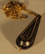 A 19th century piquet inlaid tortoiseshell pendant on a 9 ct gold chain