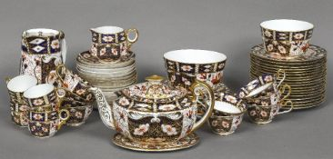A good quantity of Royal Crown Derby tea wares, pattern 2451 Comprising: teapot, cover and stand,