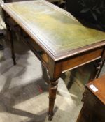 A Victorian mahogany leather top writing table