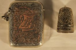 A silver vesta and a silver thimble