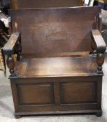 An early 20th century oak monks bench