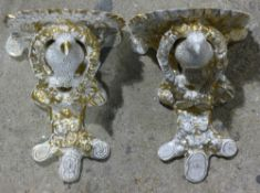 A pair of Victorian porcelain wall brackets