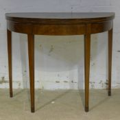 A Georgian demi-lune card table