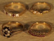 Four 9 ct gold stone set rings