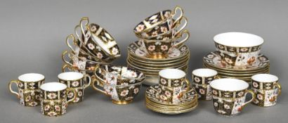 A quantity of Royal Crown Derby tea wares, pattern 2451 Comprising: six side plates, eleven saucers,