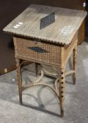 A wicker sewing/work table