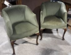 A pair of upholstered tub chairs