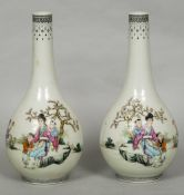A pair of Chinese porcelain baluster vases Each decorated with figures in a continuous garden