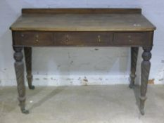 A Victorian mahogany side table