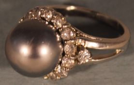 A silver and grey pearl and cubic zirconia ring