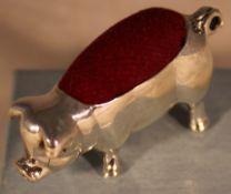 A silver pig form pin cushion