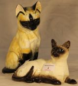 A Beswick Siamese cat and another