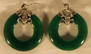 A pair of silver and jade circle earrings