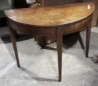 A 19th century mahogany demi lune table