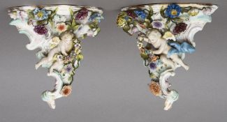 A pair of late 19th/early 20th century Sitzendorf porcelain wall brackets With floral encrusted