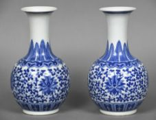 A pair of Chinese blue and white porcelain baluster vases Each decorated with lotus strapwork.