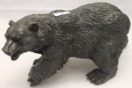 A bronze model of a bear