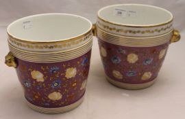 A pair of Victorian porcelain cache pot