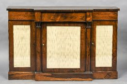 An early 19th century rosewood breakfront side cabinet The shaped top above a single frieze drawer