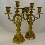 A pair of 19th century ormolu figural candlesticks