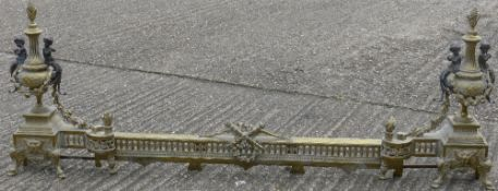 A 19th century gilt metal extending fire curb Of typical form,