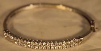 A silver and cubic zirconia bangle