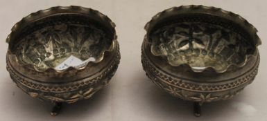 A pair of unmarked Indian white metal salts