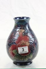 Lot 3 - Bulbous Moorcroft vase depicting Birds eating Fruit
