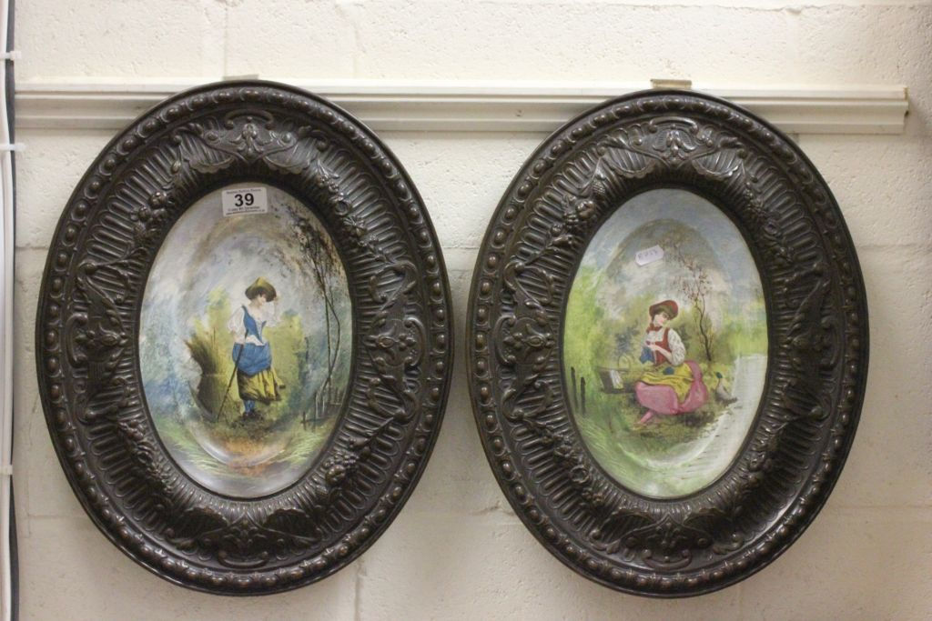 Lot 39 - Pair of French wall plaques with copper frames & hand painted ceramic scenes to centre