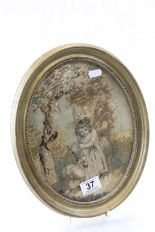 Lot 37 - An antique oval silk picture of young girl with sheep.