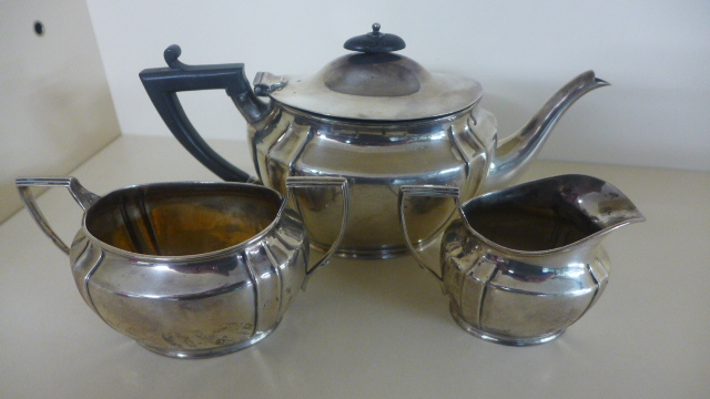 Lot 686 - A Silver Hallmarked three piece Tea Service, Edinburgh 1913-14 - consisting of a teapot,