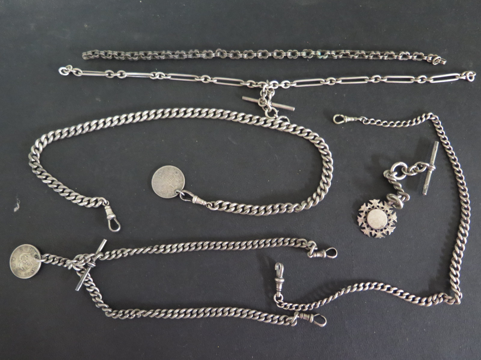 Lot 644 - Five silver watch chains - longest 44 cm,