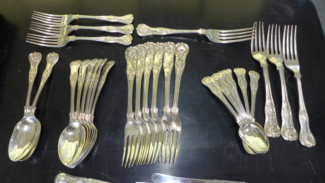 Lot 672 - A matched set of 60 pieces of silver Kings pattern cutlery comprising of different markers and