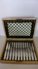 Lot 671 - A Victorian Boxed Set of 12 plated knives and forks with Mother of Pearl Handles - some plate wear