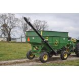 J&M 250 gravity bed, JD 1065A running gear, 12.5L-15 tires, Unverferth 14' hyd brush auger
