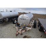 "1,200 gal. SS nurse tank, tandem axle, 2"" plumbing, pump & motor"