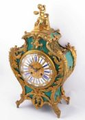 French table clock France, 19th century, relief gold plated dial, enamel panels with numbers,